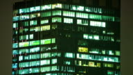 People working in office, dusk to night time-lapse