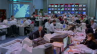 T/L, MS, People working in Television News Room