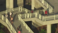 MS AERIAL People working out on staircase at university of spencer eccles bridge / Salt Lake City, Utah, United States