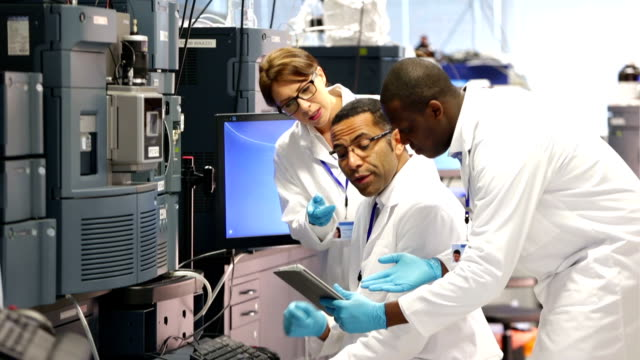 People working with Specialist Scientific Equipment in a Laboratory