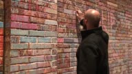 WGN People Write in Chalk on Wrigley Field Brick Wall After Cubs' World Series Win on Nov 7 2016