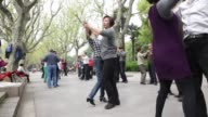 CU peoples feet as they dance in Fuxin Park in Shanghai China on Sunday April 10 People dance in pairs in Fuxin Park View of feet dancing in Fuxin...