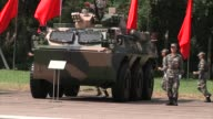 People's Liberation Army troops jog past army military vehicles after a visit by Chinese President Xi Jinping at the Shek Kong Barracks in Hong Kong...