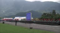 People's Liberation Army troops march in formation after a visit by Chinese President Xi Jinping at the Shek Kong Barracks in Hong Kong China on...