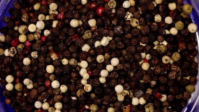 Peppercorns mix. Kitchen herbs background