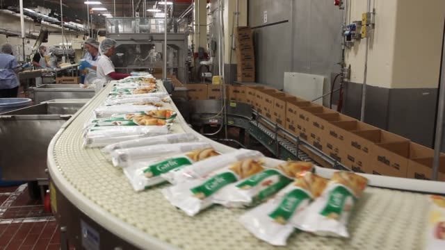 Pepperidge Farm Bread Product manufacturing Lines of dough move down a conveyer belt and into an oven Bread is baked and sorted by a large machine...
