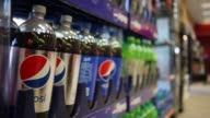 PepsiCo products are displayed for sale inside a Shell Gas Station in Louisville Kentucky US on Monday April 13 2015 Shots Close up shots of bottles...