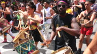 Percussion music band plays the drums as they interrupt the celebration in order to make demands to the executive committee of Pride Toronto