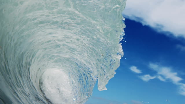 A perfect beautiful wave POV as wave breaks over camera on shallow sand beach in the California summer sun. Shot in slowmo on the Red Dragon at 300FPS.