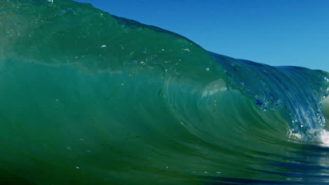 A perfect glass wave POV as wave breaks over camera on shallow sand beach in the California summer sun. Shot in slowmo on the Red Dragon at 300FPS.