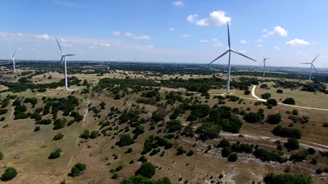Perfect Sunny Summer Wind Turbines Farm outside of Goldthwaite , Texas near Lampasses and Austin TX