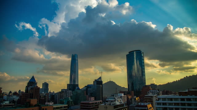 Perfect Sunset time lapse coulds moving over Titanium and Costanera Gran Torre Santiago, Santiago de Chile