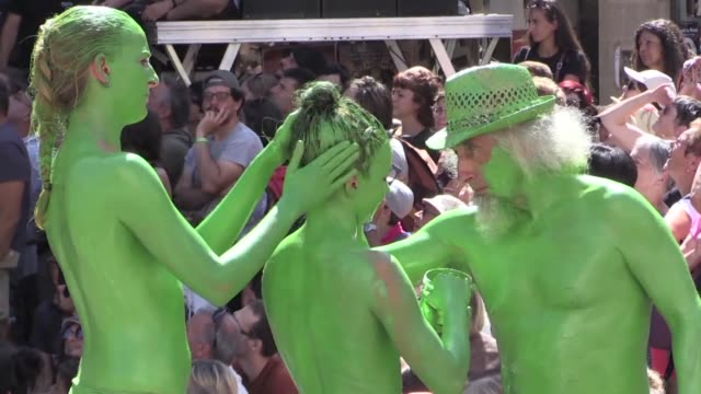 Performances at the international street theater festival in Aurillac France delight audiences with dance and music flying cars and body paint
