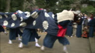 Performers dance during a lion procession in Takaoka, Japan.