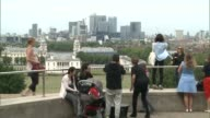 London Greenwich EXT People looking at London cityscape view from Greenwich Park Back view General James Wolfe statue next to Greenwich Observatory...