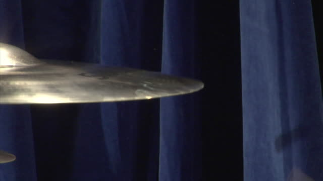CU Person hitting cymbal with drum stick