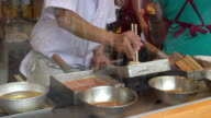 Person making Tamagoyaki