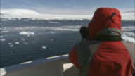 CU, Person on ship looking through binoculars, rear view, Antarctica