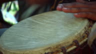 Person Playing African Drum