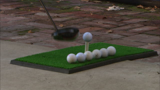CU, Person practicing golf in backyard, Los Angeles, California, USA