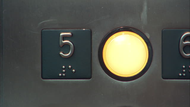 ECU Person pressing elevator button, Los Angeles, California, USA
