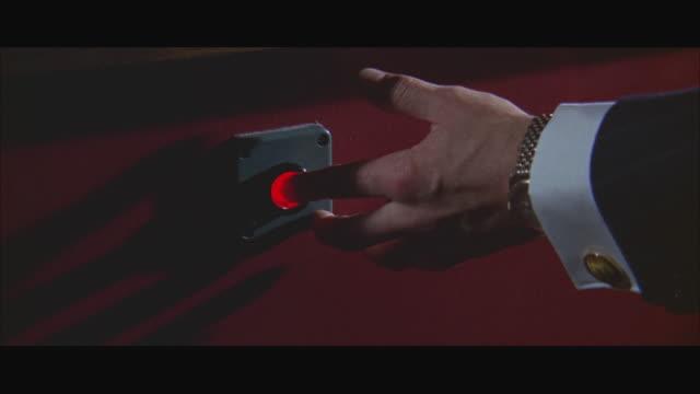 1966 CU Person pushing button