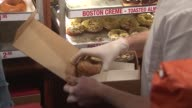 Person Putting Donuts In A Box on December 12 2013 in Chicago Illinois