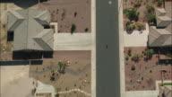 AERIAL WS TS Person riding bike through suburbs / Las Vegas, Nevada, USA