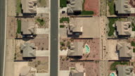 AERIAL WS TS Person riding bike through suburbs / Las Vegas, Nevada, USA