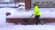 Person Salting Sidewalk on January 02 2014 in Chicago Illinois
