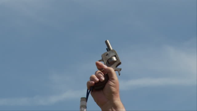 CU, person shooting gun in the air, view of hand holding gun / Atlanta, Georgia, USA