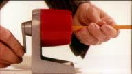 1958 ECU SELECTIVE FOCUS Person using pencil sharpener / USA / AUDIO
