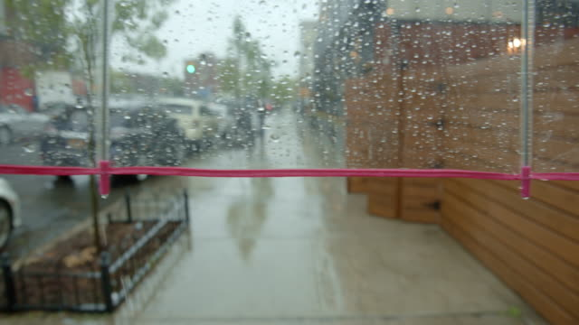 POV person walking on sidewalk umbrella rain