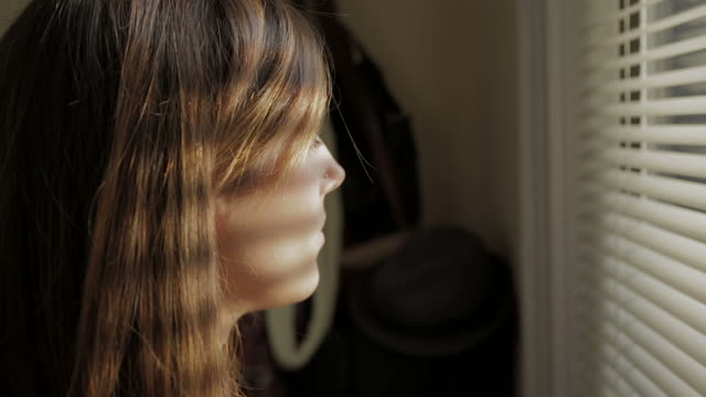 Person Young sad wondering woman Window Face Expression Emoting People