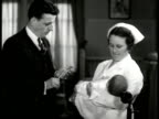 CU 'Personal' adoption ad MS Man nurse holding baby EXT WS Welfare League building Washington DC DRAMATIZATION VS Committee members talking about...