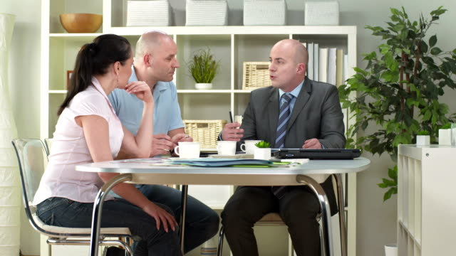 HD DOLLY: Personal Financial Advisor Talking With Couple