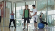 WS DS Personal trainer instructing people for exercise / Vancouver, British Columbia, Canada