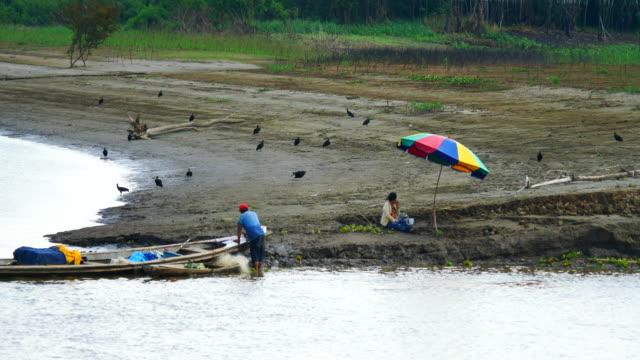 Peru, Amazon basin, a local fisherman close to the Marañón River riverbank, Pacaya Samiria National Reserve