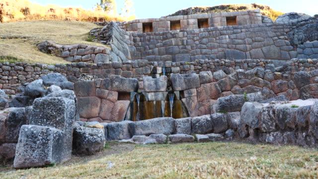 Peru, Waterfalls running through the terraced rocks in Tambomachay archeological site