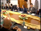 Pervez Musharraf speaks and gestures at a meeting with Sulejman Tihic and dignitaries