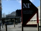 Gvs The Royal Festival Halls and the National Theatre / ms electronic sign at top of the NT / vs embankment gardens by Thames pan to NT / Nude...