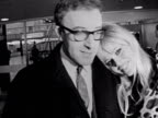 Peter Sellers and Britt Ekland kiss and pose for photographers at London Airport 1964