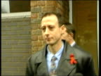 Peter Tachell church protest ITN Tony Benn MP interview SOT this is an obselete act Tatchell towards out of court carrying poster 'Defend the right...