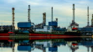 Petrochemical industry - Oil refinery with reflection, Time lapse