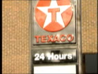 Petrol prices cut LIB Petrol pump showing sale figures Texaco prices sign TILT GV BP petrol station