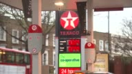 London EXT General views Texaco petrol station with CoOperative store / Police car along / Petrol prices / Petrol pumps / Shell petrol station Shell...