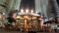 WS Petronas towers with entrance of Surya Kuala Lumpur City Center Shopping Complex at KLCC / Kuala Lumpur, Malaysia
