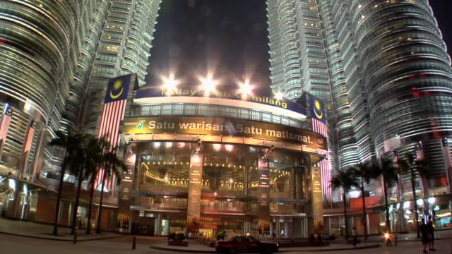 WS Petronas towers with entrance of Surya Kuala Lumpur City Center Shopping Complex at KLCC / Kuala Lumpur, Malaysia