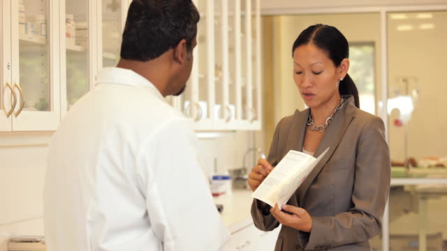 'pharmaceutical sales rep talking to a doctor /Richmond,Virginia, USA'