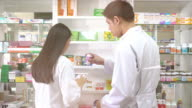Pharmacist checking the product